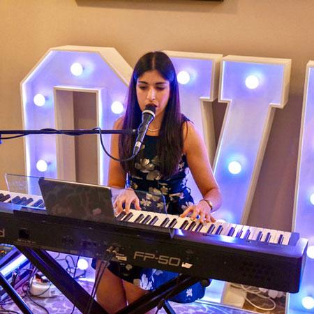 Carolina Garcia-Cox - Singer and Pianist