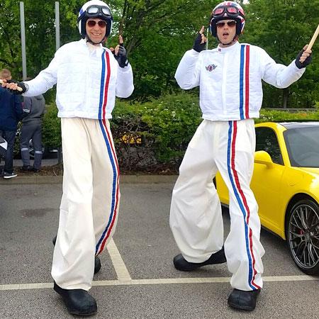 Joy Magnet - Racing Car Drivers Stilt Walkers