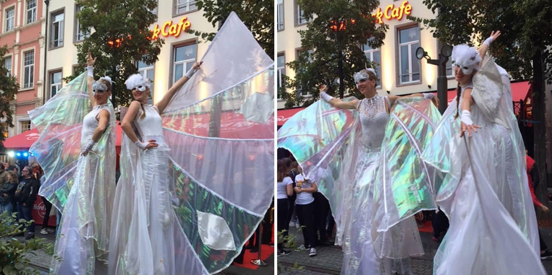 Elegant Stilt Walkers Entertain Guests At Hard Rock Café Brussels