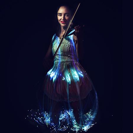 Mia Jones Electric and Luminous Violinist