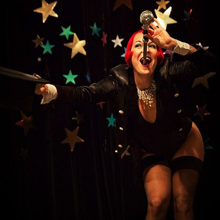 Gin Minsky - Burlesque Sideshow Act (sword swallowing and blockhead)