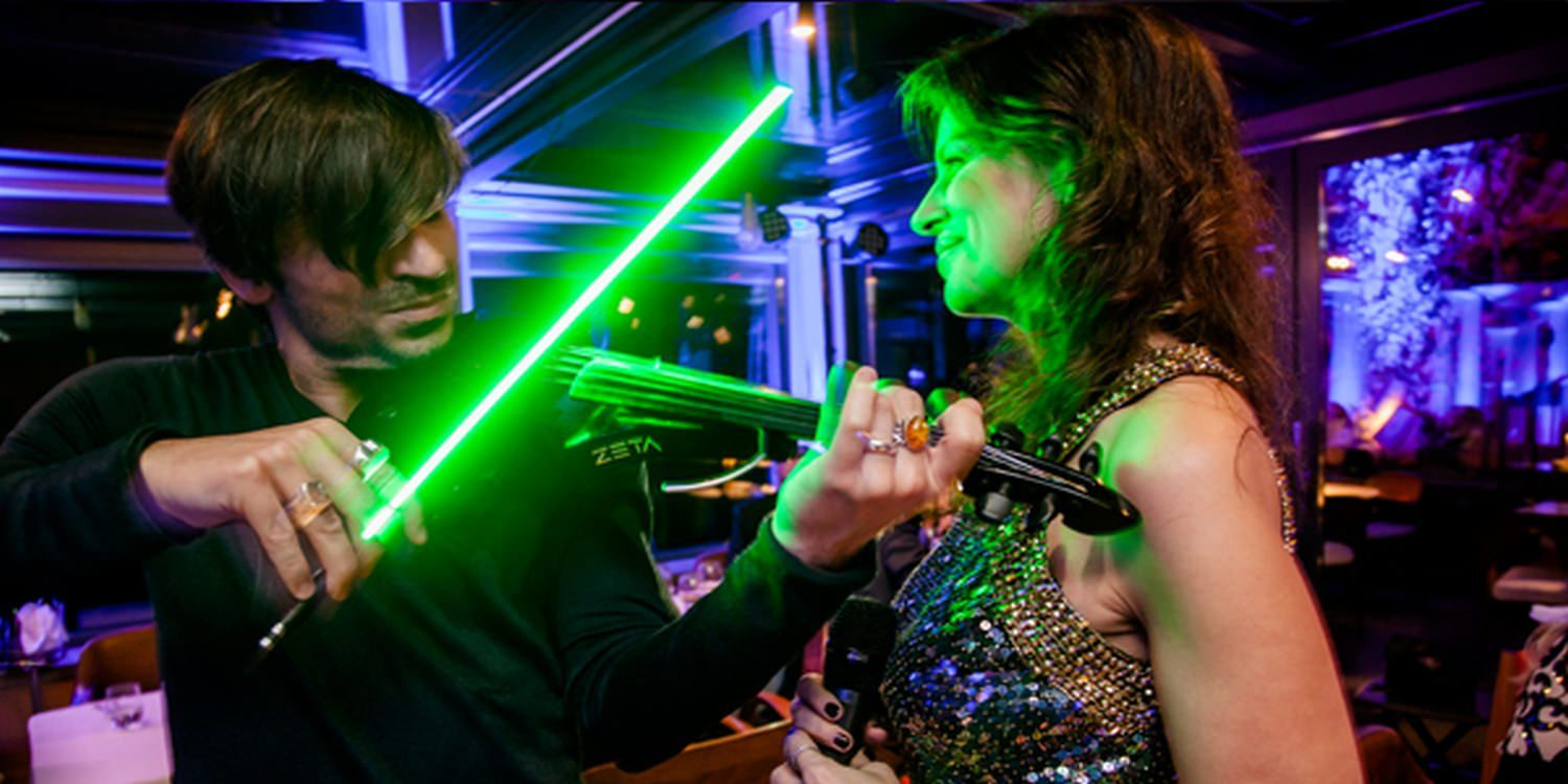 LED Violinist Wows At Rome Dinner Event