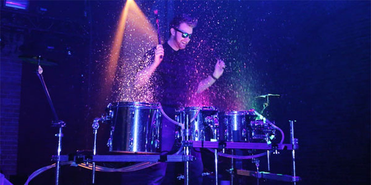UV Water Drummer Amazes At Neon Nights Themed Party