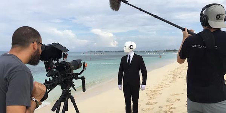 Real Life Humanoid Flies To Cayman Island For Video Shoot